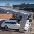 Solar awnings over parking lots aid business as well as consumers